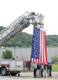 CTVFC and Harmony Fire District with the raising of the flag.